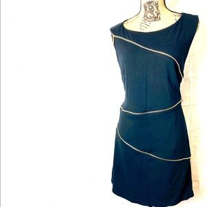 Adore black and white sheath dress wit zippers.